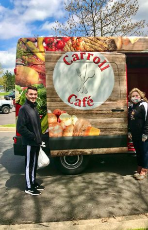 Senior, Irvin Castillo, and Mrs. Krone pose in front of the Carroll Café food truck.