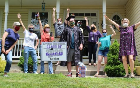 Staff celebrate with graduate and staff writer, Declan Browning, in front of his home.