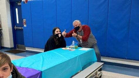 Mr. Danaher congratulates Chloe Mettle for making Honor Roll